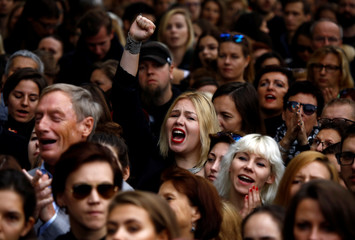 Woman shouts slogans as she takes part in abortion rights campaigners' demonstration in front of the Parliament in Warsaw