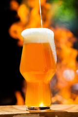 Mug of beer on wooden tabled. Still life photography of light beer glass.