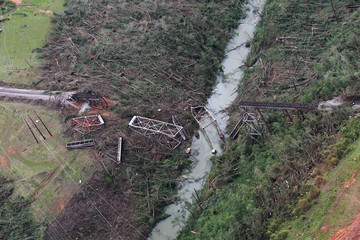 An aerial view shows tornado damage to train trestles just outside Tuscaloosa Alabama