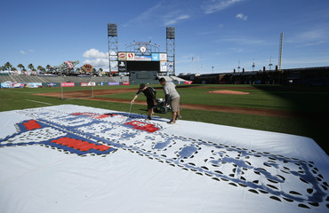 Grounds crew paint the World Series logo onto the field at ATT Park in San Francisco