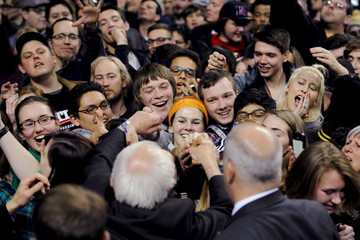 Supporters of Democratic U.S. presidential candidate Bernie Sanders reach for a handshake at a campaign rally in Green Bay, Wisconsin