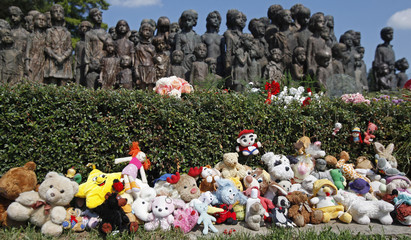 Teddy bears are placed at the Lidice Memorial during a remembrance ceremony honouring the 69th anniversary of the destruction of Lidice village by Germans, in Lidice