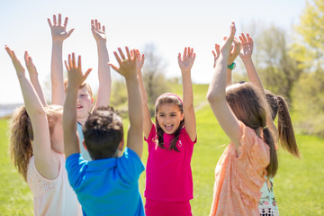 Group of child have fun on a field hand high