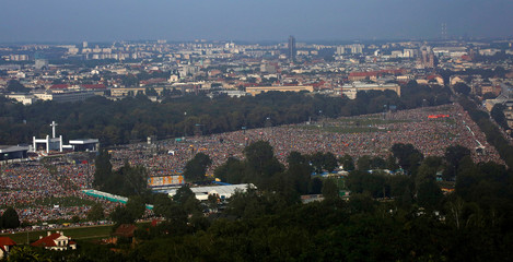 Pilgrims attend the Way of the Cross at Blonia Park during World Youth Day in Krakow