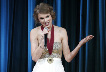 Singer and songwriter Taylor Swift speaks as she accepts an award at the 58th annual BMI Pop Awards in Beverly Hills