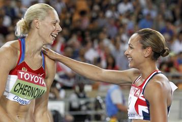 Tatyana Chernova of Russia celebrates winning the women's heptathlon with Jessica Ennis of Britain in Daegu