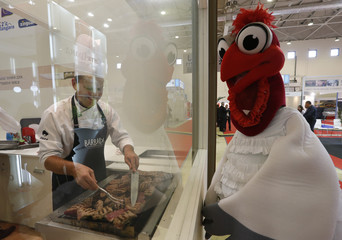 A participant cooks meat, produced in Brazil, during the WorldFood Moscow 2014, an international food and drinks exhibition covering sectors of the food industry, in Moscow