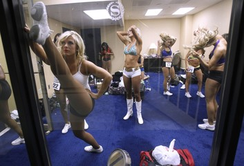 """Ravens cheerleader contestants warm up before performing during an event called """"Making the Cut"""" to select the final Baltimore Ravens cheerleaders in Baltimore"""