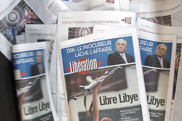 View of front page of French daily morning newspaper Liberation in La Courneuve
