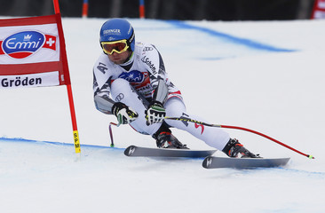 Baumann of Austria clears a gate during the men's World Cup Super-G skiing race in Val Gardena