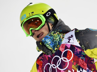 Kazakhstan's Dmitriy Reiherd reacts at finish line during men's freestyle skiing moguls finals at 2014 Sochi Winter Olympic Games in Rosa Khutor