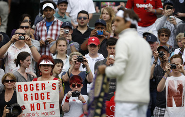Roger Federer of Switzerland arrives on Court One for his men's singles tennis match against Albert Ramos of Spain at the Wimbledon tennis championships in London