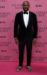 Model Tyson Beckford wears camouflage pattern shoes with dinner suit as he arrives for the 2014 Victoria's Secret Fashion Show in London