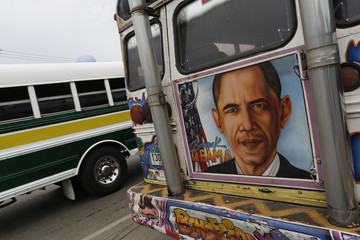 Graffiti including a portrait of U.S President Barack Obama is seen on the back of a bus known as Diablo Rojo in Panama City