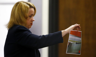 Assistant Attorney General Starnes shows a picture of a ninja sword to the jury during the capital murder trial of former Marine Corporal Routh at the Erath County, Donald R. Jones Justice Center in Stephenville, Texas