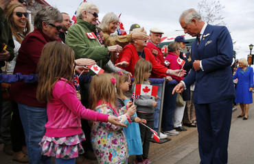 Britain's Prince Charles greets people in Pictou, Nova Scotia