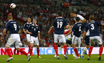 England's Lambert heads to score against Scotland during their international friendly soccer match against England in London