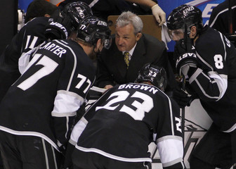 Los Angeles Kings head coach Darryl Sutter talks to his players in a third period time-out against the Vancouver Canucks during Game 4 of their NHL Western Conference Hockey quarter-final playoff in Los Angeles