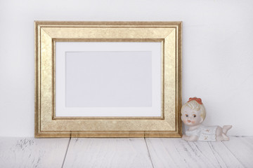 Stock photography golden picture frame cute baby girl doll mock up for text message