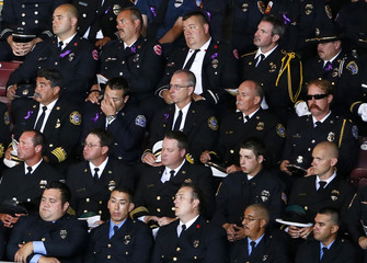 Firefighters listen to a memorial service for the fallen members of the Granite Mountain Hotshots, in Prescott Valley