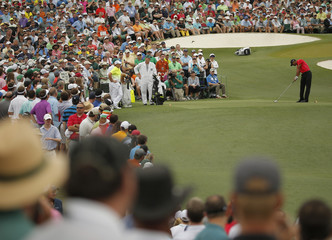 Tiger Woods of the U.S. hits off the third tee during the final round of the Masters golf tournament at the Augusta National Golf Course in Augusta