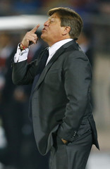 Mexico's coach Miguel Herrera directs his team during their first round Copa America 2015 soccer match against Chile at the National Stadium in Santiago