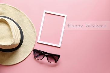 Happy Weekend text and Panama hats and sunglasses on pink background ,copy space