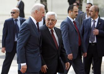 U.S. Vice President Biden walks with Palestinian President Abbas before their meeting in Ramallah