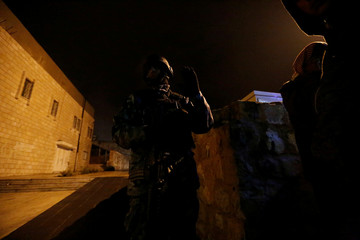 Jordanian policemen stand guard in the vicinity of Kerak Castle where armed gunmen carried out an attack, in the city of Karak