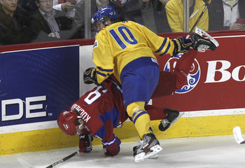 Sweden's Larsson checks Russia's Kucherov in the first period of play during the gold medal game of the 2012 IIHF U20 World Junior Hockey Championship in Calgary
