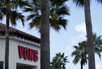 The entrance to a Vons grocery store is shown between palm trees in Solana Beach, California