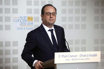 France's President Francois Hollande delivers a speech during a visit at the Ligue Contre le Cancer? centre in Paris