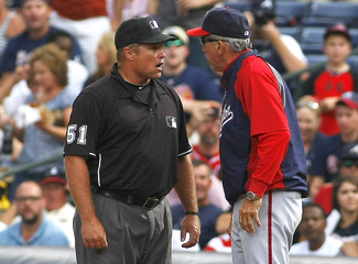 Washington Nationals manager Johnson argues with umpire Hudson during their MLB game against the Atlanta Braves in Atlanta