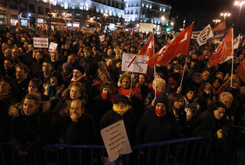 Public sector workers take part in a march against proposed cuts by Madrid's regional government in downtown Madrid