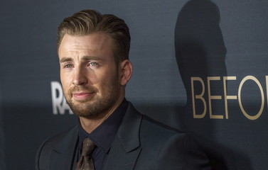 """Director and cast member Evans poses at the premiere of """"Before We Go"""" in Los Angeles"""