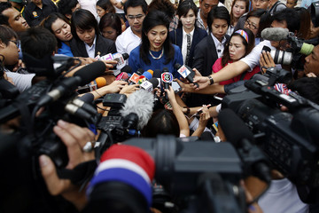 Thailand's PM Yingluck speaks to reporters after casting her ballot in elections for Bangkok's governor at a polling station in Bangkok