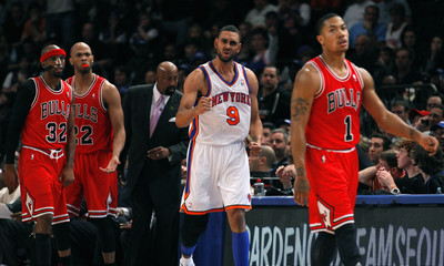 Chicago Bulls point guard Rose, New York Knicks forward Jeffries, Knicks interim head coach Woodson, Bulls' Gibson and Hamilton react after the ball was awarded to the Knicks in the fourth quarter of their NBA game