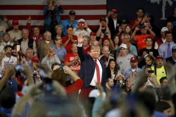 Republican U.S. presidential candidate Trump waves to the crowd at the conclusion of a presidential forum in Aiken