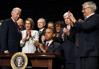 U.S. President Obama signs into law the Dodd-Frank Wall Street Reform and Consumer Protection Act in Washington