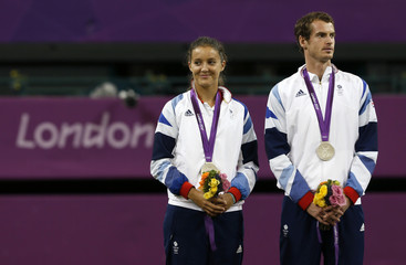Britain's Murray he stands with teammate Robson during the presentation ceremony for tennis mixed doubles at the All England Lawn Tennis Club during the London 2012 Olympic Games
