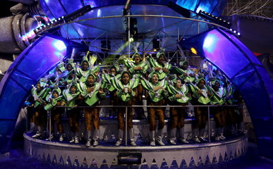 Revellers parade for the Imperio de Casa Verde samba school during the carnival in Sao Paulo, Brazil