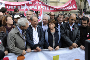 French Socialist Party head Martine Aubry and party members attend a nationwide strike over pension reforms in Paris