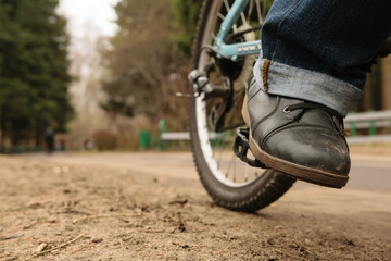 Woman leg on the pedal