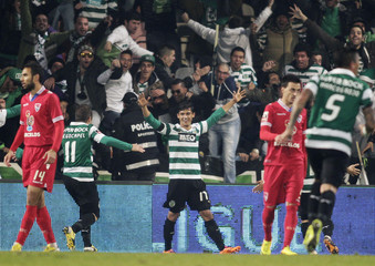 Sporting Lisbon's Montero celebrates his goal against Gil Vicente with his teammate Cedric during their Portuguese Premier League soccer match at the Municipal stadium in Barcelos