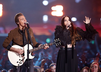 Musician Matthew Koma and singer Miriam Bryant perform at the 2014 MTV Movie Awards in Los Angeles
