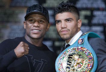 Mayweather Jr. and WBC welterweight champion Ortiz pose during a news conference at the MGM Grand hotel-casino in Las Vegas