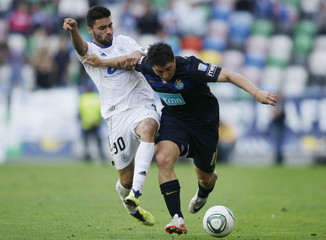 CD Feirense's Fonseca and Porto's Rodriguez fight for the ball during their Portuguese Premier League soccer match at municipal stadium in Aveiro