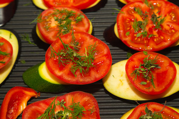 Slices of fresh vegetables on a grill pan surface. Selective focus. Shallow depth of field