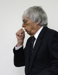 Formula One boss Ecclestone coughs as he arrives for the sixth day of his trial at the regional court in Munich