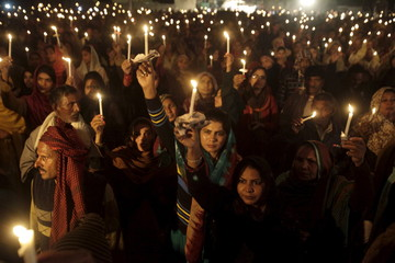 Pakistani Christians hold candles to pay tribute and pray for victims of the Army Public School attack in Peshawar on the anniversary of the attack at a ceremony in Lahore